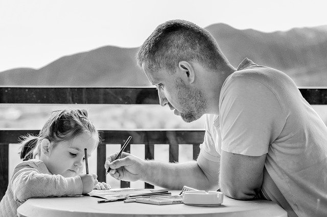 Girl and dad doing homework - back to school