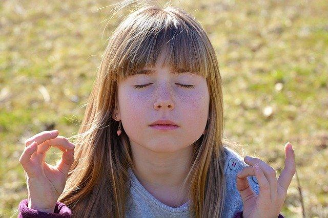 Girl meditating - back to school
