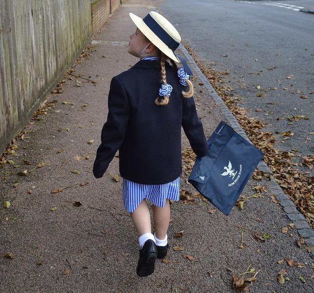 Girl walking school uniform- back to school
